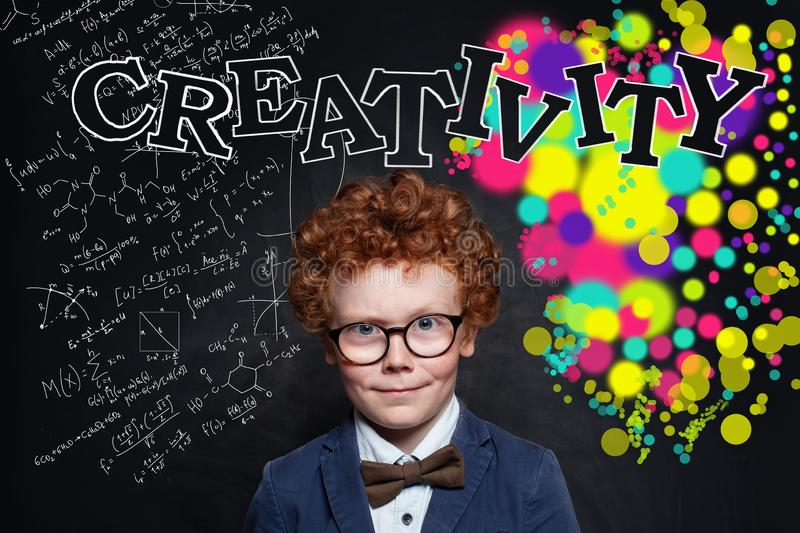 Creativity background with cute kid boy in glasses.  stock images