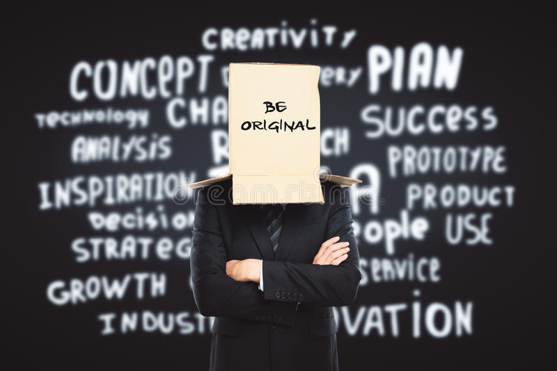 Creativity concept. Businessman with cardboard box on head. Dark backgroud with inspirational text. Creativity concept royalty free stock photo