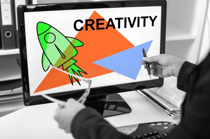 Creativity concept on a computer monitor. Businesswoman showing creativity concept on a computer screen royalty free stock photos