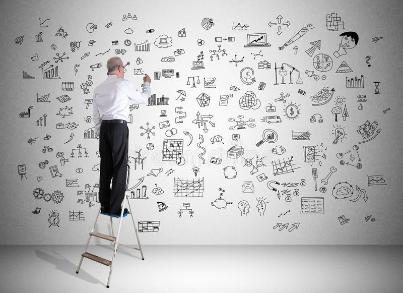 Creativity concept drawn by a man on a ladder royalty free stock images