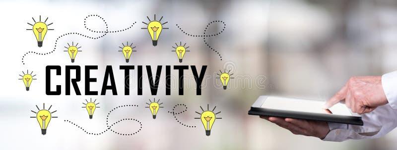 Creativity concept with man using a tablet. Man using a tablet with creativity concept royalty free stock photos
