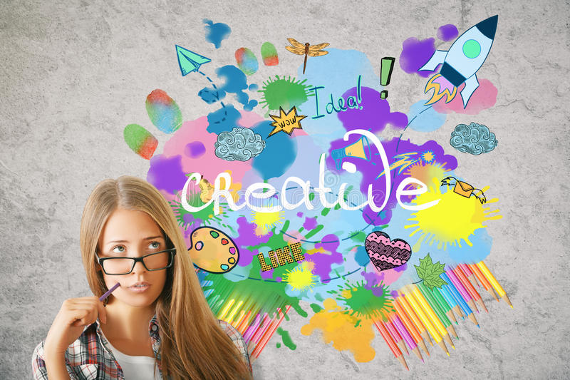 Creativity concept. {ortrait of attractive thoughtful european female with bright colorful sketch. Creativity concept royalty free stock photos