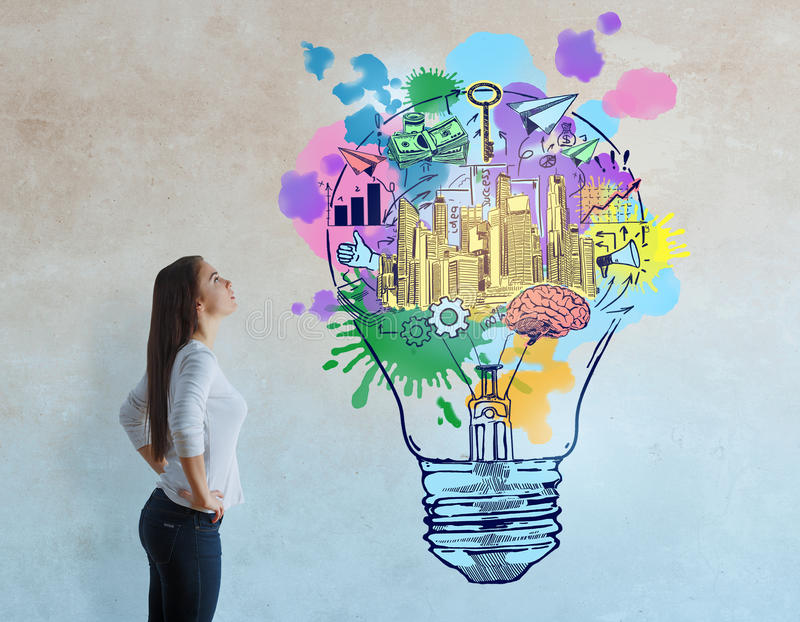 Creativity concept. Side view of thoughtful european woman on concrete background with colorful business sketch. Creativity concept stock image