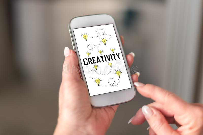 Creativity concept on a smartphone. Held by a hand royalty free stock photos