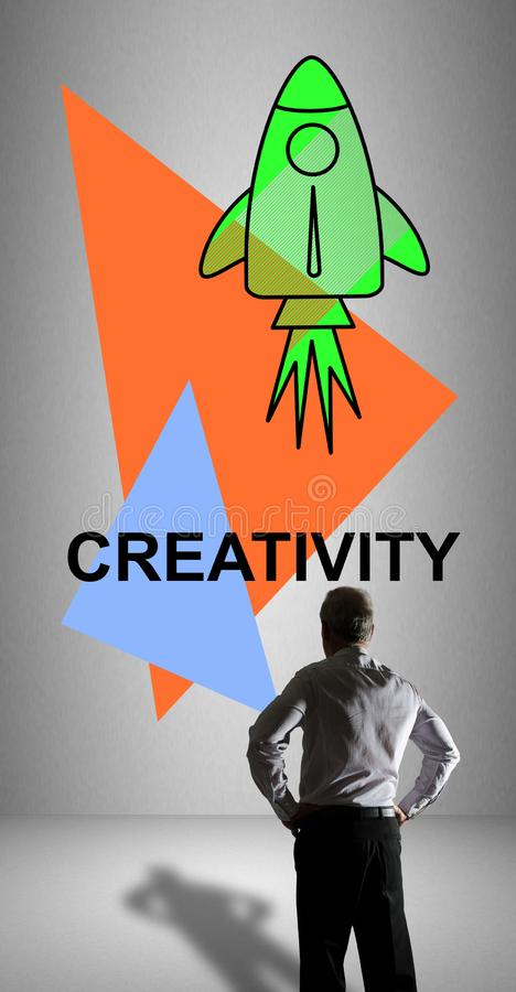 Creativity concept watched by a businessman. Businessman watching a creativity concept drawn on a wall stock photos