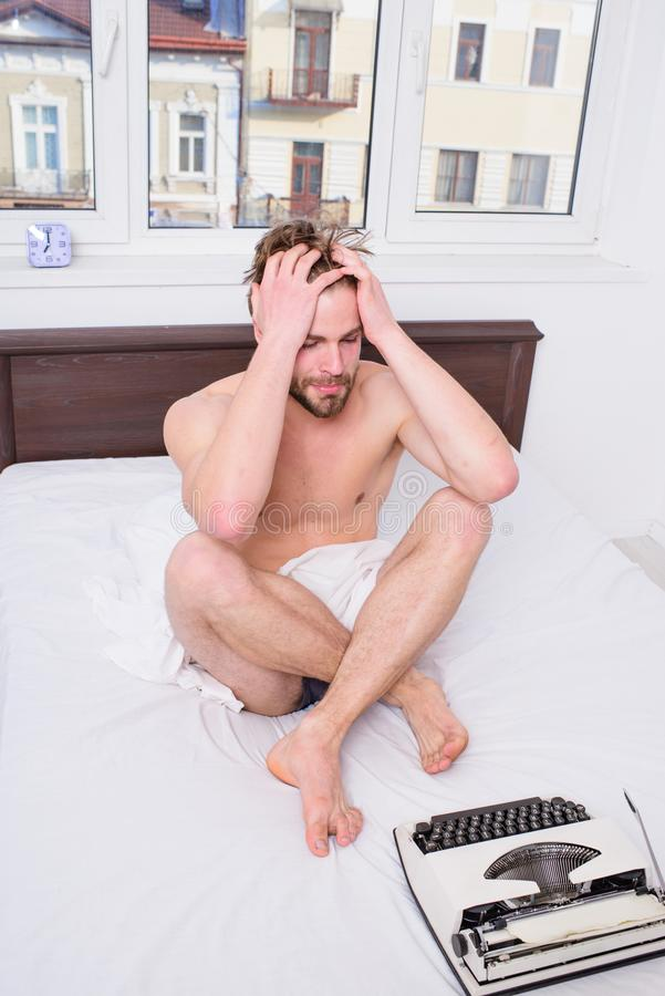 Creativity crisis. Writer tired desperate author used old typewriter. Man writer sit bedclothes work book. Need some. Fresh creative idea. Author looking for royalty free stock image
