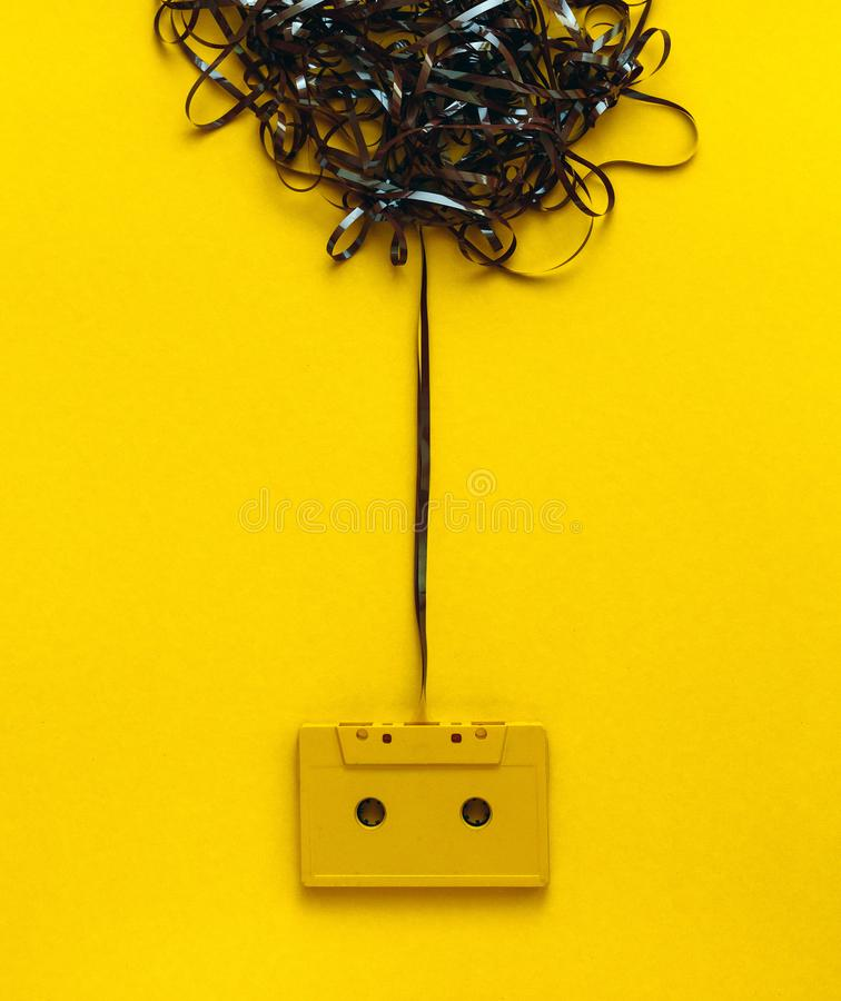 Creativity Design Concept. Retro audio tape On Yellow Background, Top View. Retro audio tape On Yellow Background, Top View. Creativity Design Decor Concept royalty free stock photography