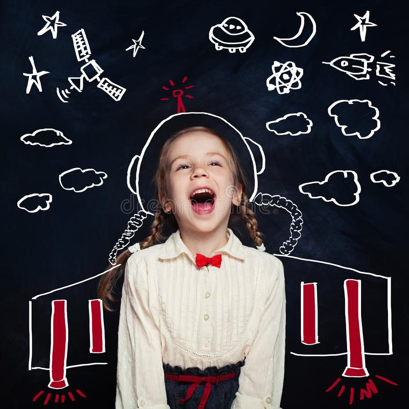 Creativity education with child girl astronaut. Kids inspiration in successful education with creative imagination. Back to school, science, technology stock photography