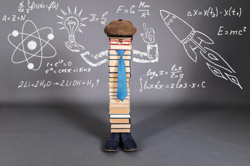 Creativity Education Concept with unusual teacher. Of mathematics, physics and chemistry stock image