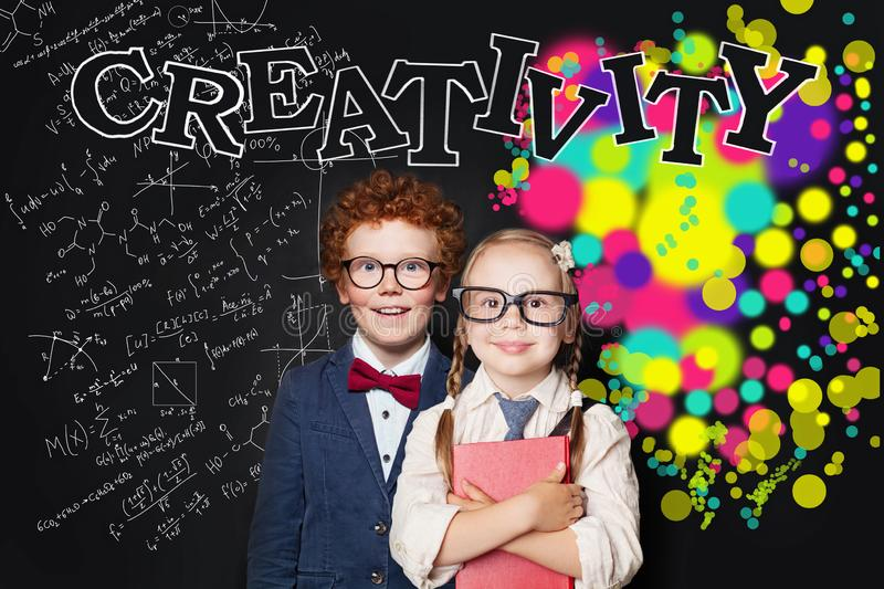 Creativity education and left hemispheres of the brain concept. Cute smart girl and boy in glasses portrait royalty free stock photo