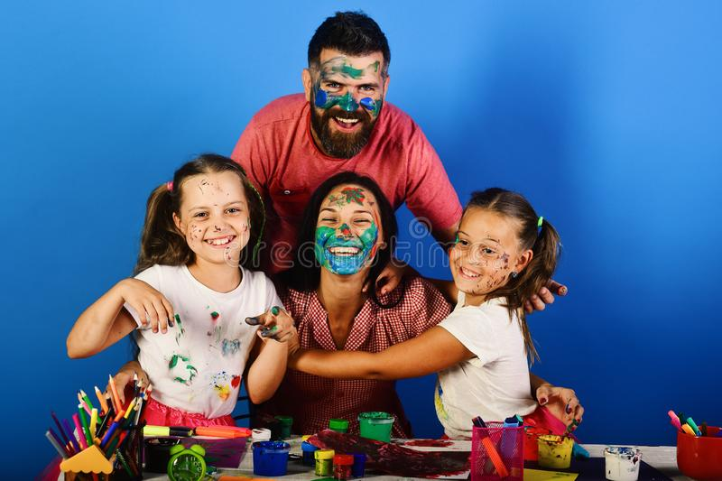 Creativity and family concept. Girls, man and woman stock image