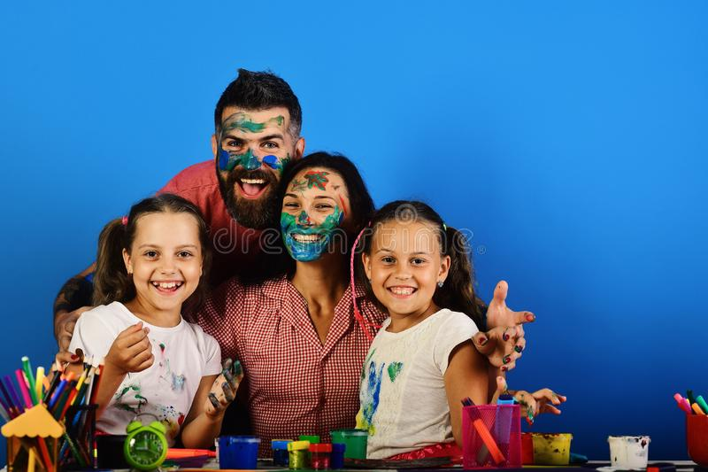 Creativity and family concept. Parents and children stock photo