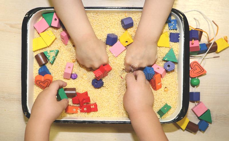 Children playing with kinetic sand, croup and designer in preschool. The development of fine motor concept. Creativity Game. Creativity Game concept. Children stock image