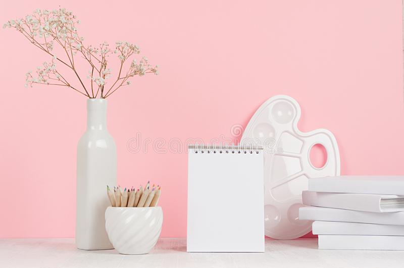 Creativity school background for girl`s - white stationery, palette, pencils and blank notepad on soft pink wall and white wood. Creativity school background stock photography