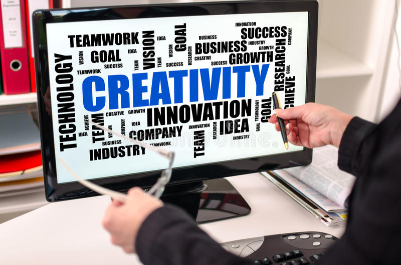 Creativity word cloud concept on a computer monitor royalty free stock image