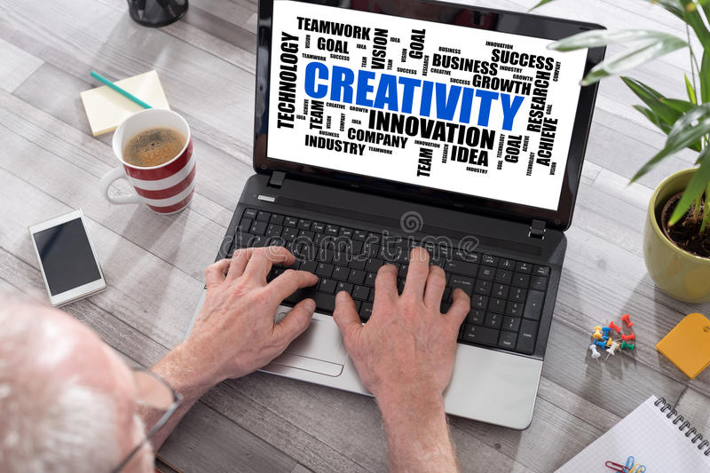 Creativity word cloud concept on a laptop screen royalty free stock photo