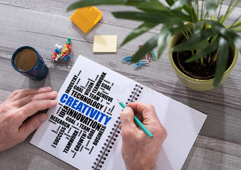 Creativity word cloud concept on a notepad stock photography