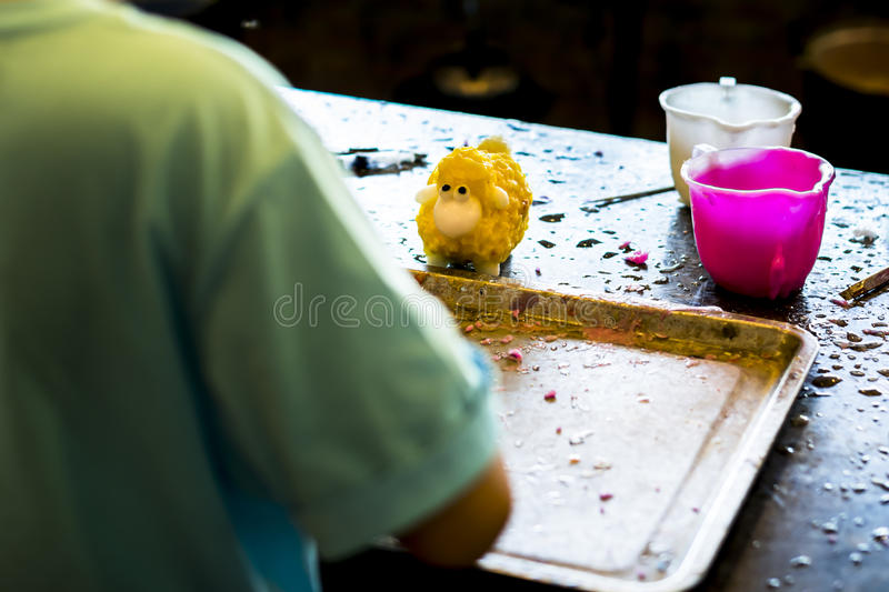 Creativity workshop. Statues carved from candles drippings. Handwork stock photography
