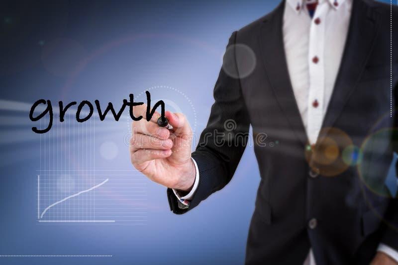 Crecimiento de la escritura del hombre de negocios imagen de archivo