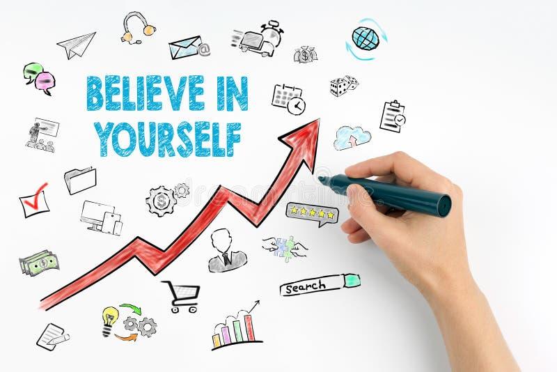 Credi in voi stesso il concetto Mano con scrittura dell'indicatore immagine stock