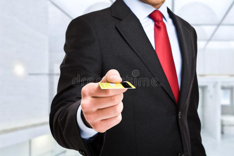 Credit card. Businessman using a credit card royalty free stock photo