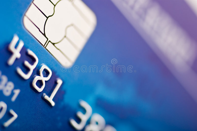 Credit card. Close-up of silver digits and chip on a credit card Shallow depth of focus stock images