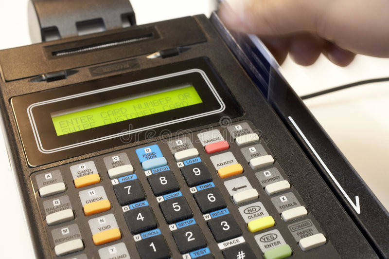Credit Card. Swipe through terminal hand in motion stock images