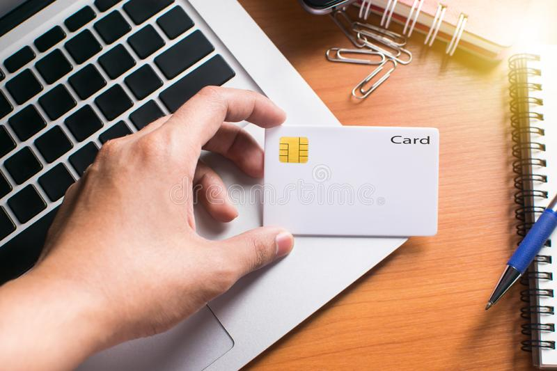 Credit card. Businessman Checking the transfer payment With holding a credit card royalty free stock photography