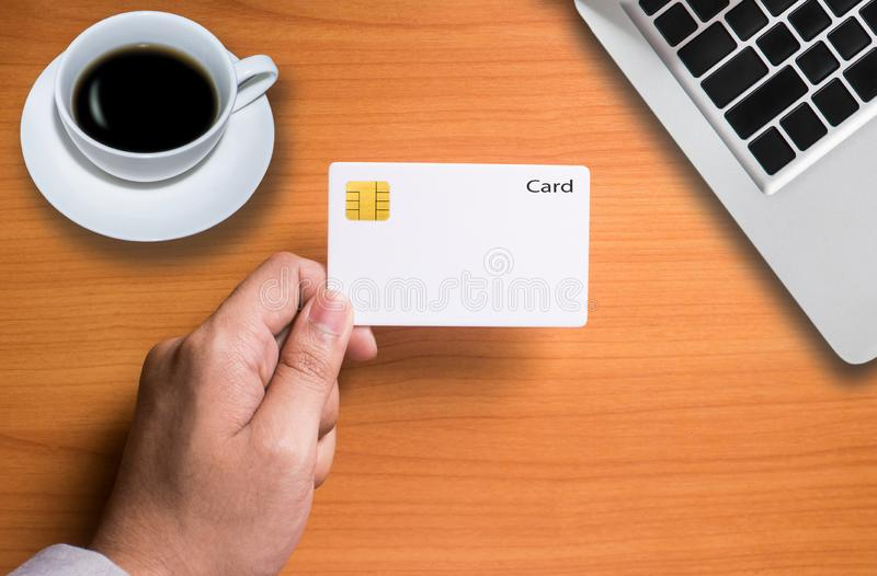Credit card. Businessman Checking the transfer payment With holding a credit card stock photo