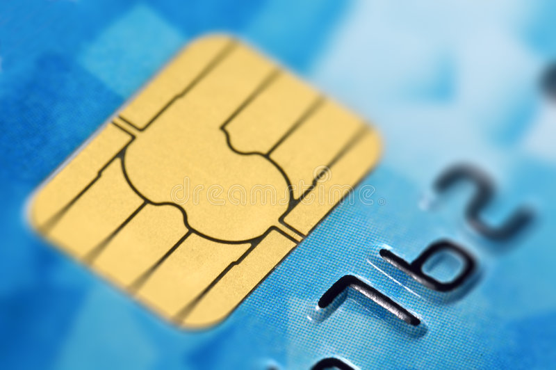 Credit Card with Chip. Close-up of digits on a credit card with computer chip. Very shallow depth of field. Focus on numbers 7 and 6. Visible texture of the card stock photos