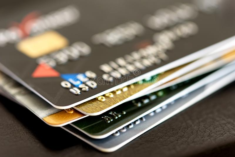 Credit card close-up. Plastic card on black background stock images
