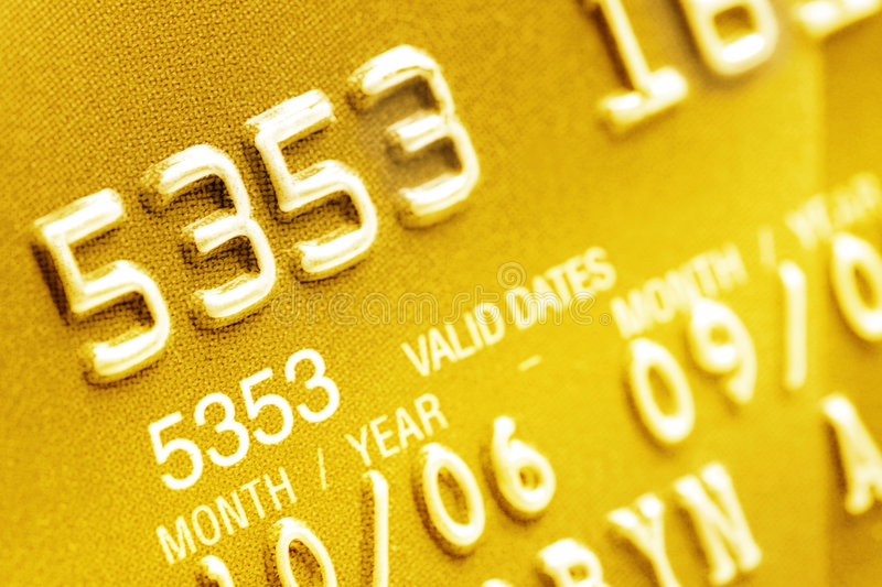 Credit Card Closeup. Macro of digits on a gold credit card royalty free stock images