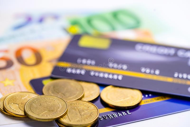 Credit card with coins and Euro banknotes : Financial development, Accounting, Statistics, Investment Analytic research data. Credit card with coins and Euro stock photography