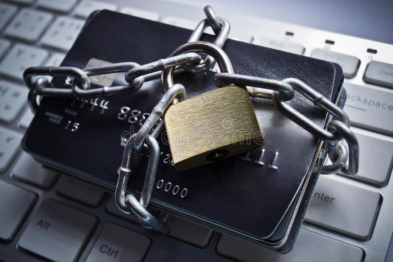 Credit card data protection. Chained credit cards - credit card data encryption protection concept royalty free stock photos