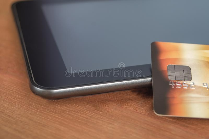 Credit card or debit card on tablet ,shopping online. Concept stock photo