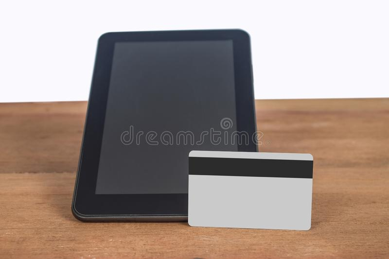 Credit card or debit card on tablet ,shopping online. Concept stock image