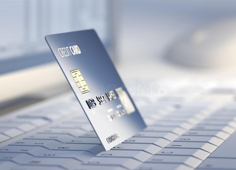 Credit card at desktop computer royalty free stock photography