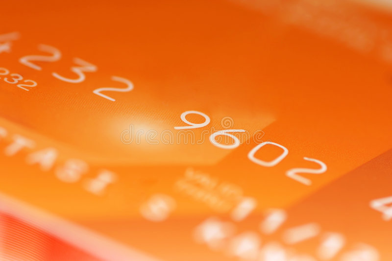 Credit card digits. Macro shoot of a credit card. Perfect for background use stock photography
