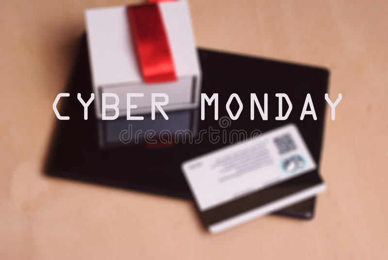 Credit card and electronic tablet on wooden table, royalty free stock photography