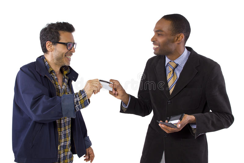 Credit Card Fraud. Con-artist stealing a customers credit card information stock photos