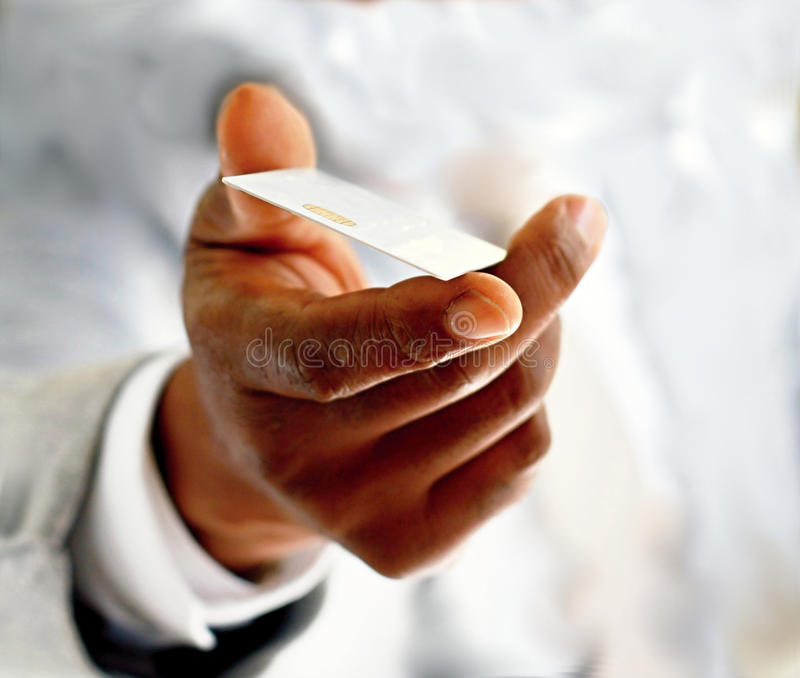 Credit card. Image of a businessman making an online payment by his credit card royalty free stock photos