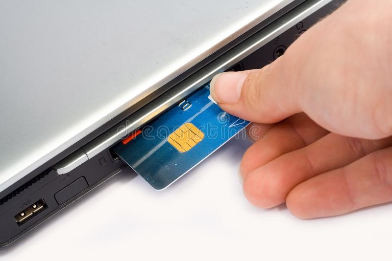 Credit card inserted in laptop stock image