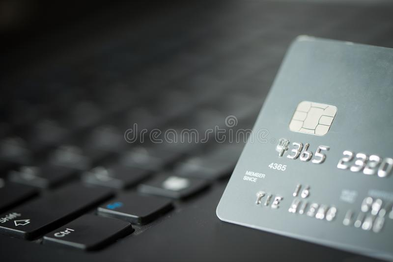 Credit card on laptop. For online payment or shopping concept stock photos