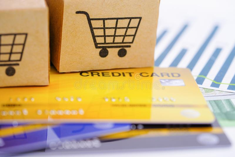 Credit card model with shopping cart box : Financial development royalty free stock photography