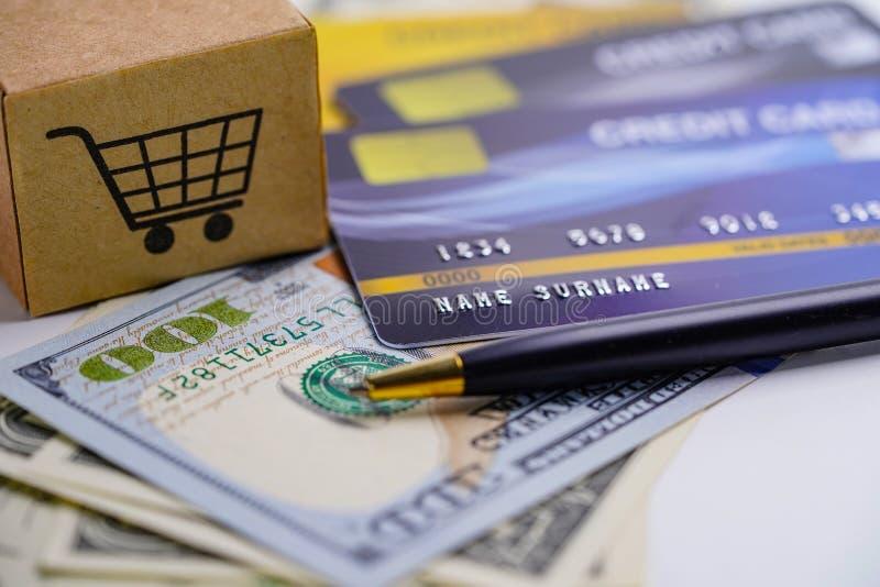 Credit card model and US dollar banknotes with shopping cart box stock photo
