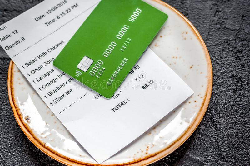 Credit card for paying, plate and check on cafe stone desk backg. Credit card for paying, plate, pen and check on cafe gray stone desk background stock image