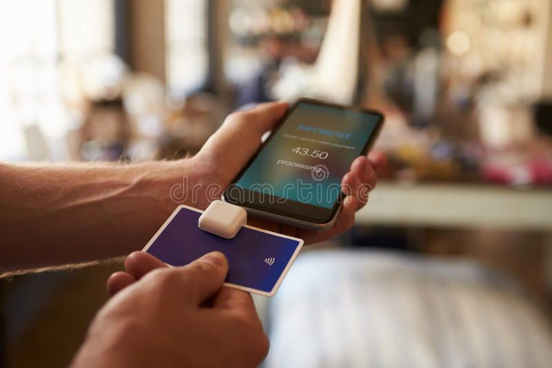 Credit Card Payment App Attached To Mobile Phone stock photography