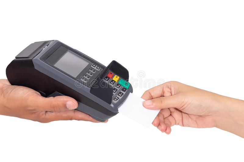 Credit card payment concept. close-up hand insert credit card mock up with white blank card with a card swipe machine terminal royalty free stock photo