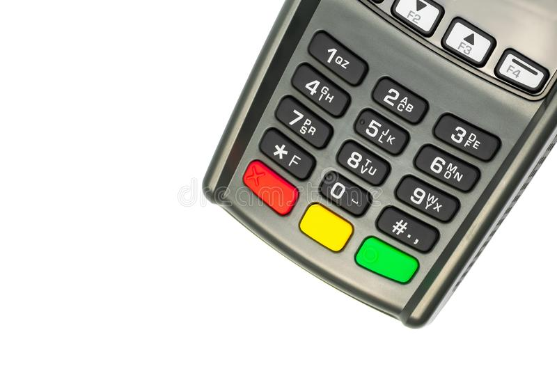 Credit card POS terminal gray keypad  on white background. A device for conducting financial transactions with customers. royalty free stock photo