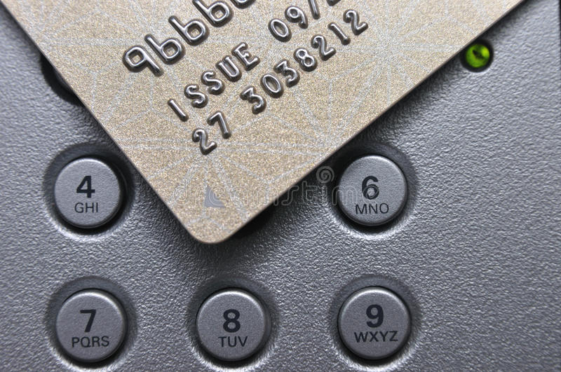 Credit card and push button. A credit card and sliver push button and a LED light together royalty free stock photo